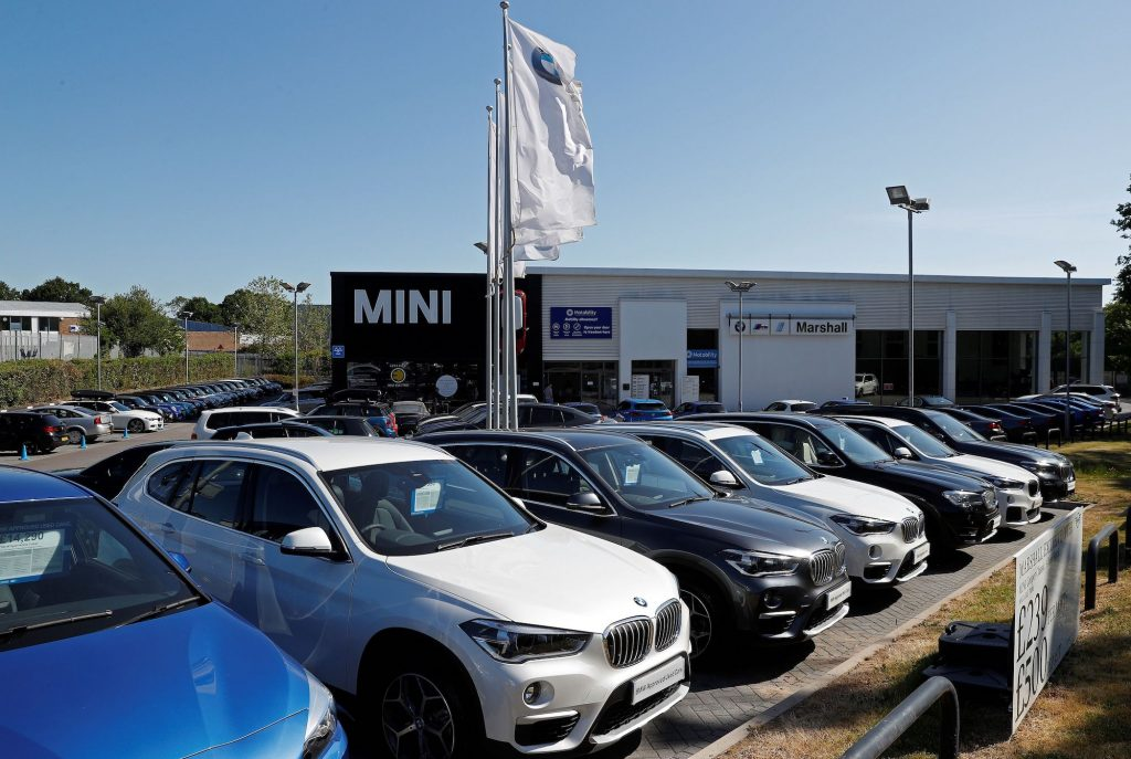 New and used cars are pictured on the forecourt at a re-opened BMW car dealership, in Hook, southwest of London, following the easing of the lockdown restrictions during the novel coronavirus COVID-19 pandemic