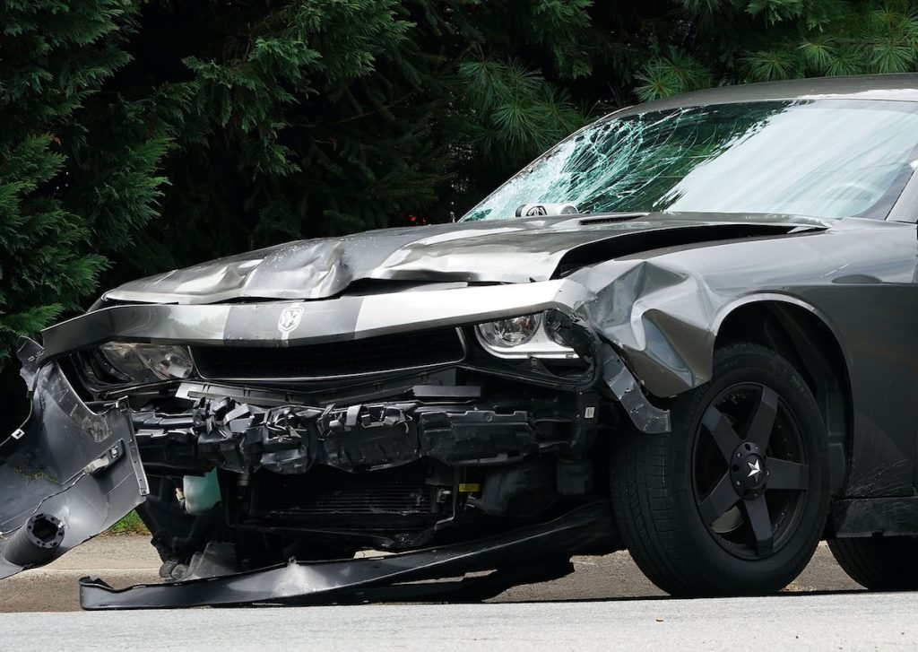 The front end of a vehicle after a car accident