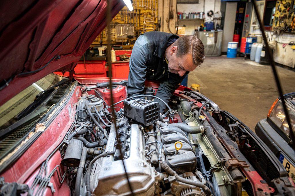 Car mechanic doing repair work