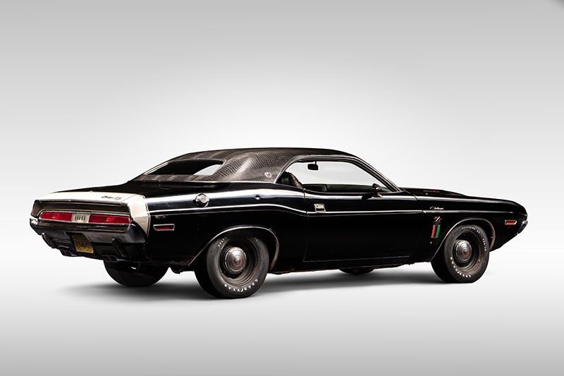 A photo of a 1970 Dodge Challenger in a photo studio.