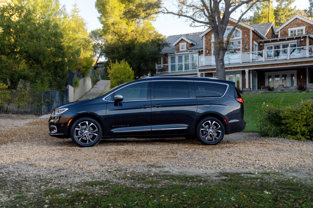 A black 2021 Chrysler Pacifica parked in front of a house