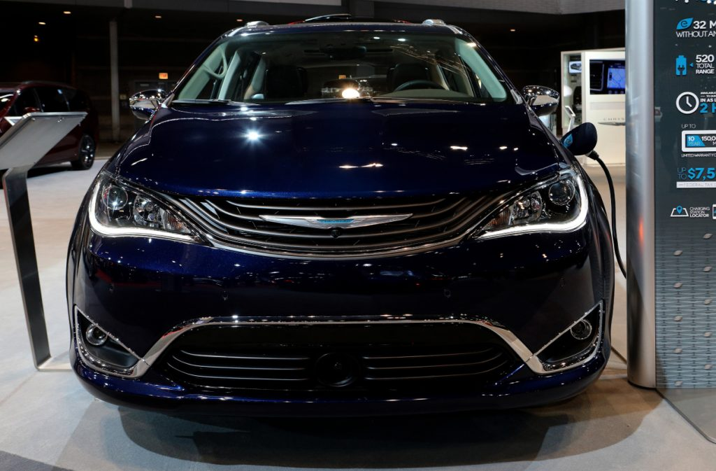 A Chrysler Pacifica Hybrid on display at an auto show