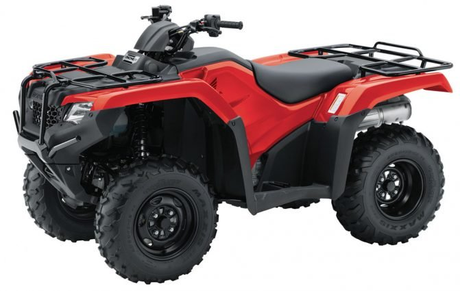 a red honda rancher ATV in a press photo against a white backdrop