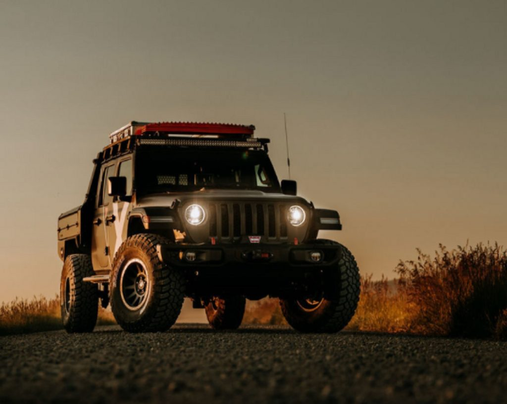 The front view of Expedition Overland's 2019 Jeep Gladiator at sunset