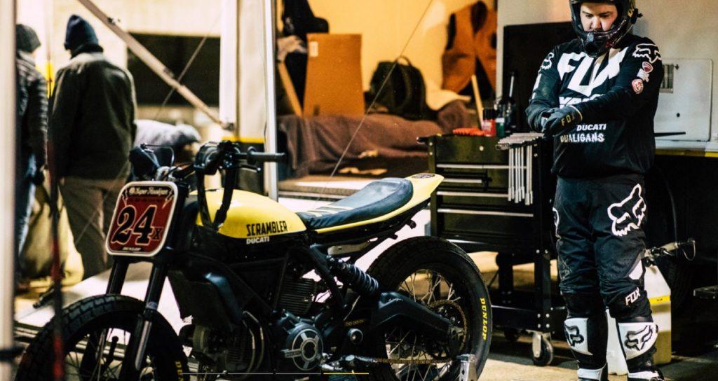 Frankie Garcia getting ready to race on his yellow Ducati Scrambler flat-tracker