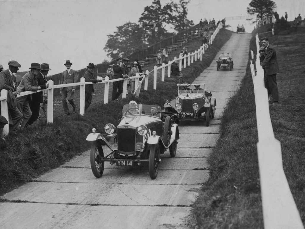 Frazer-Nash cars undergoing reliability testing on a paved hill
