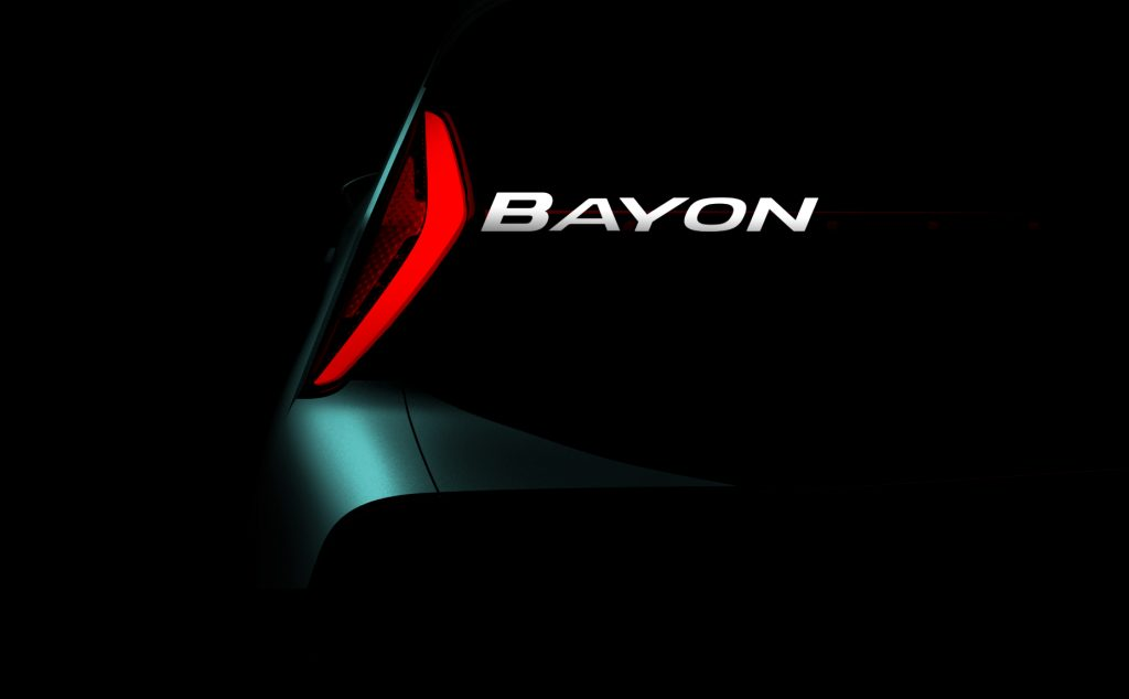 The Hyundai Bayon logo near the LED taillight light surrounded by a black background