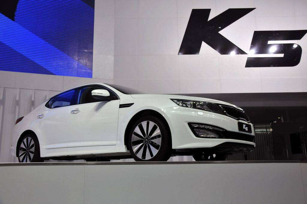 A Kia K5 being debuted in China
