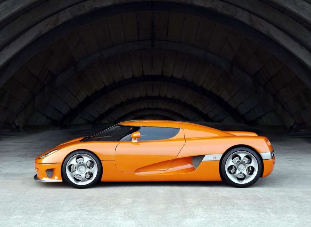 A photo of a 2004 Koenigsegg CCR at an airplane hangar.