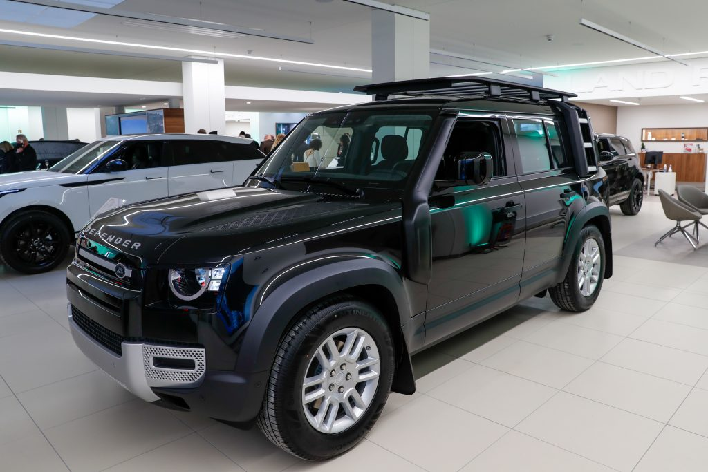 "A Land Rover Defender is on display at the showroom opening of the ""Land Rover and Jaguar"" brands"
