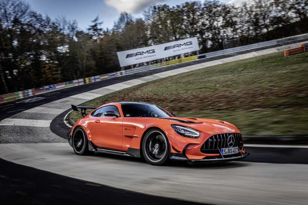 The record-breaking orange Mercedes-AMG GT Black Series driving on the Nürburgring course