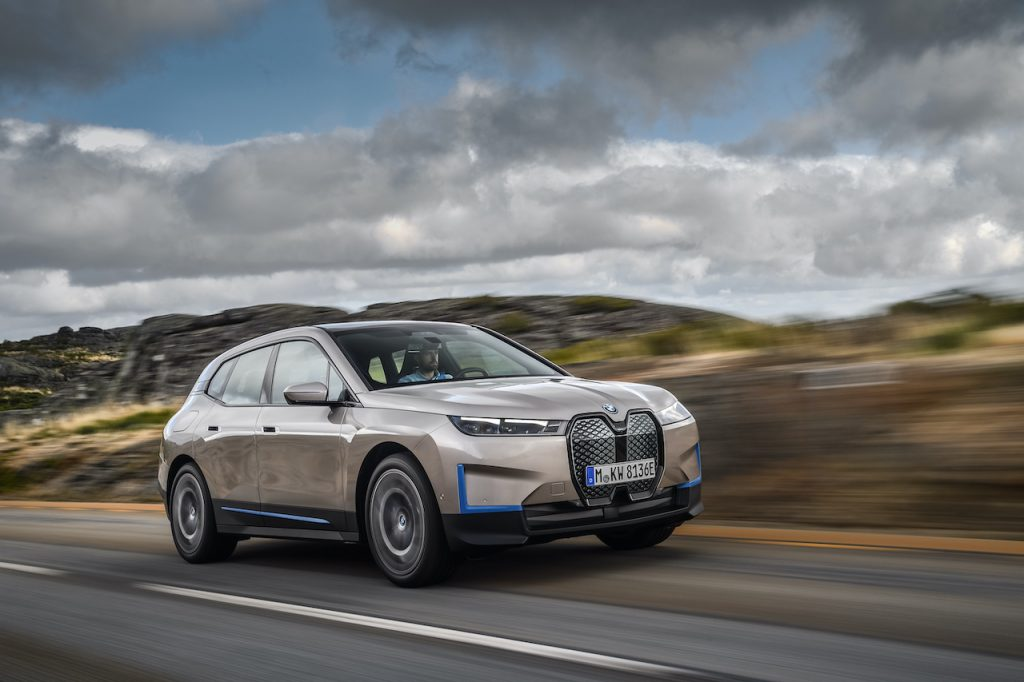 A photo of the BMW iX out on the road.