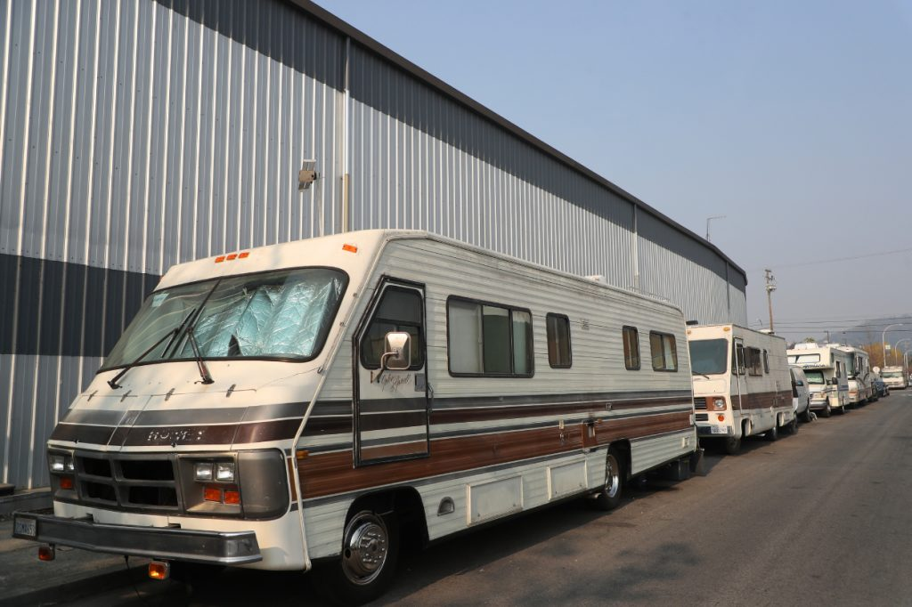 RVs parked along the side of a building