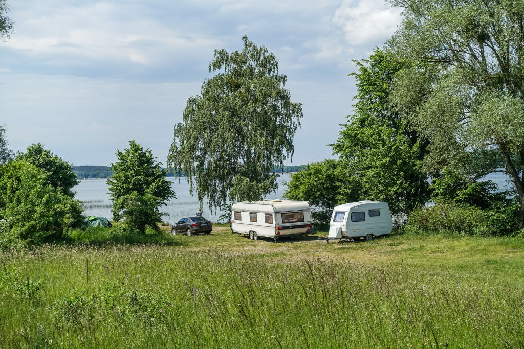 An RV is parked near a lake