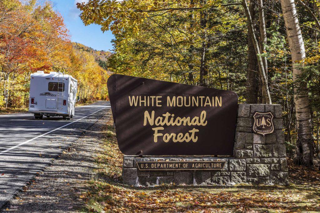 An RV driving through a national park
