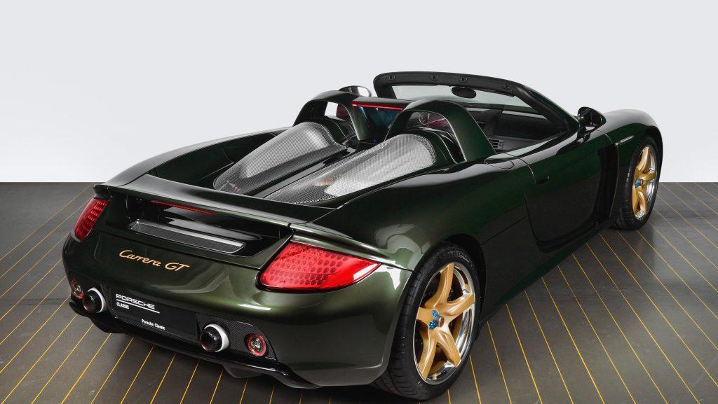 A dark-green Porsche Carrera GT restored by Porsche Classic