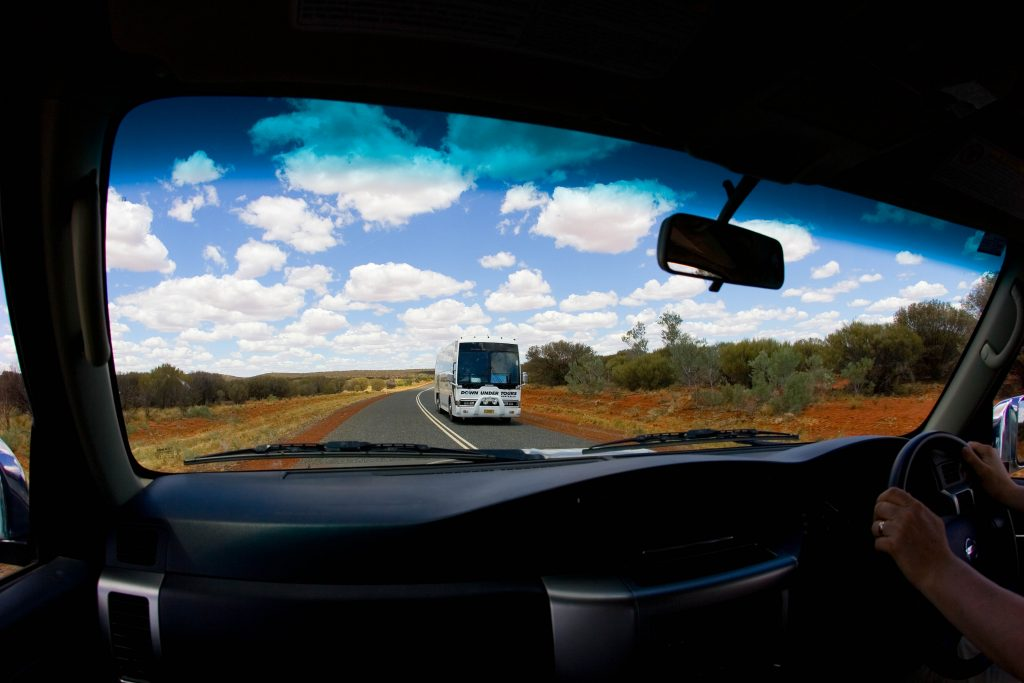 The view of the road from inside a right-hand drive vehicle.