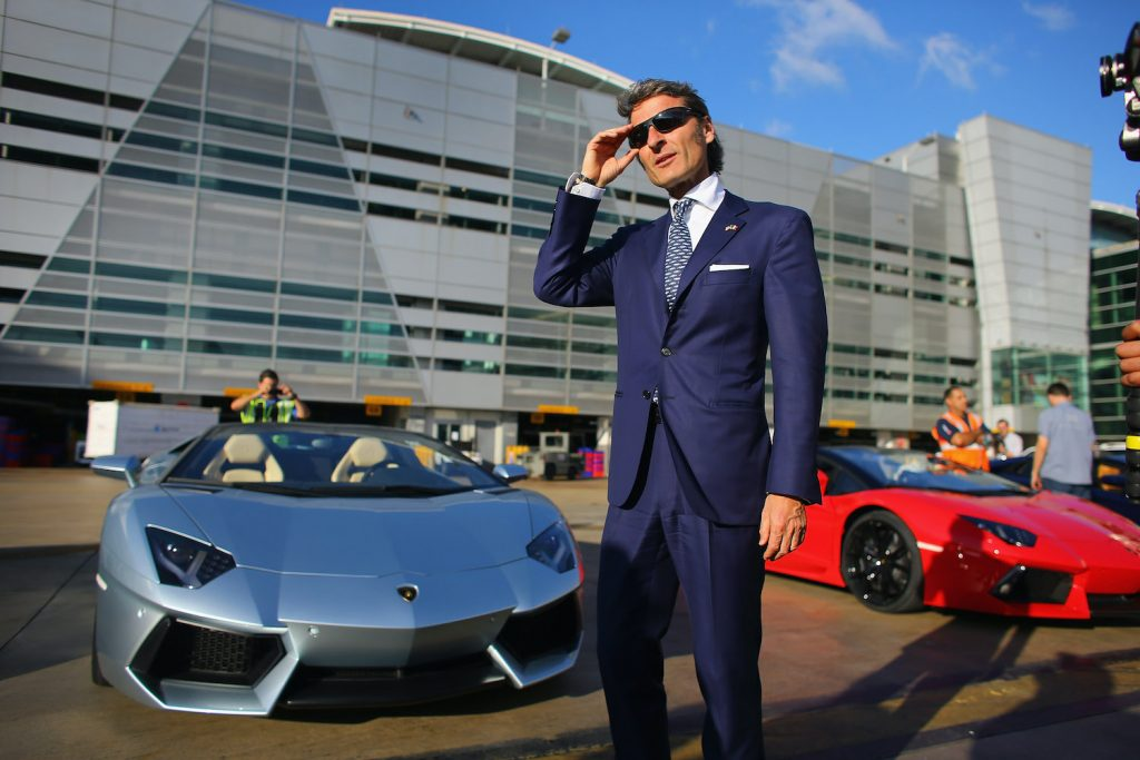 CEO of Lamborghini Stephan Winkelmann stands near the new Lamborghini Aventador LP700-4 Roadster at the Miami International Airport on January 28, 2013 in Miami, Florida. The world wide unveiling of the new luxury super sports cars took place at the airport.