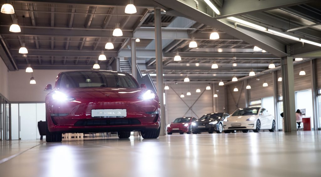 A Tesla Model 3 (l) and other Tesla models are on display in the new Tesla Service Center