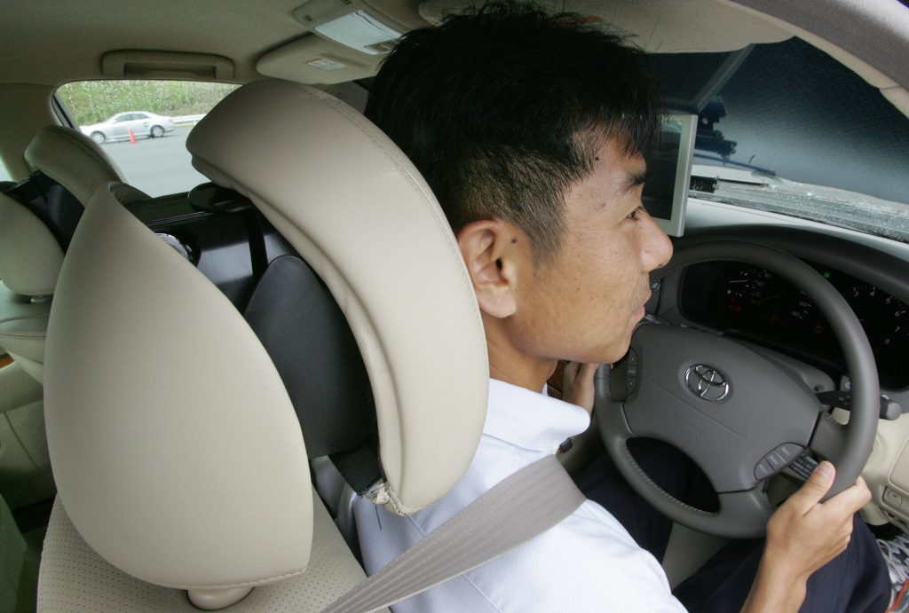 man using car headrest