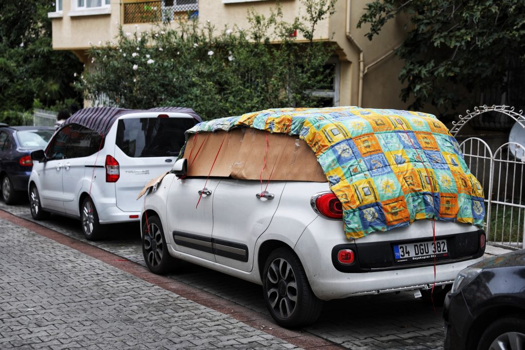 cars covered with blankets for hail protection