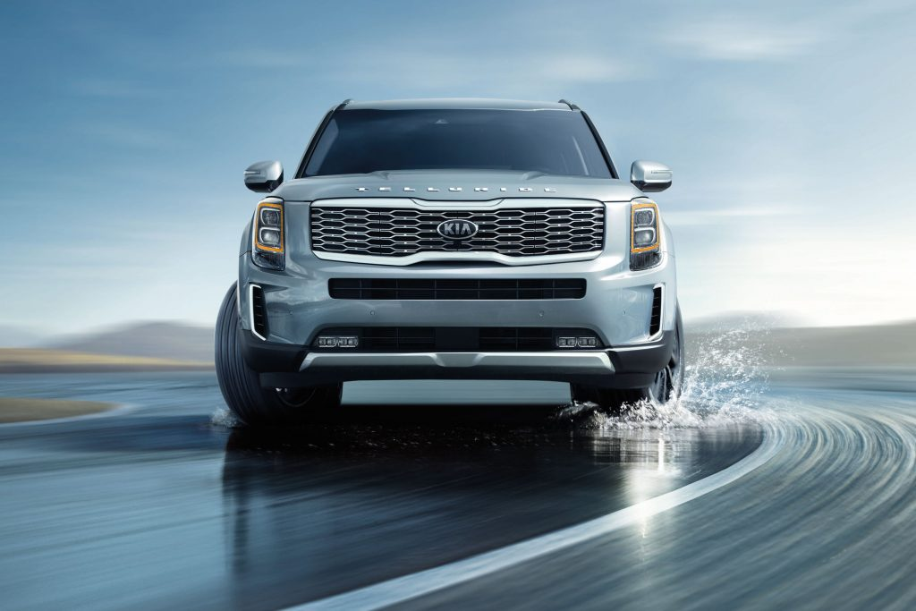 A chrome 2021 Kia Telluride navigating in water.