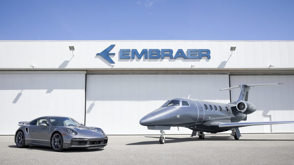 Porsche 911 Turbo S and Embraer Jet