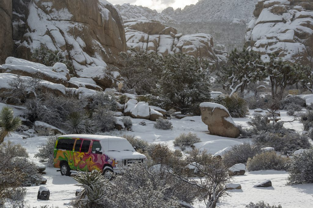Snow blankets Joshua Tree National Park and RV camper van