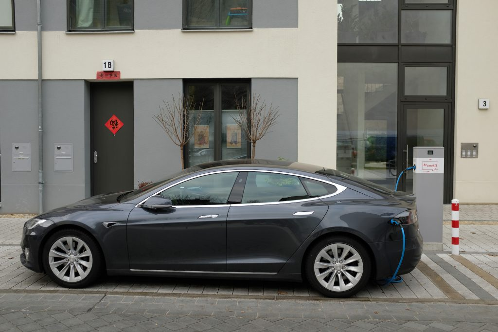 A Tesla Model S electric car charges at a public charging column on March 2, 2019, in Berlin, Germany.