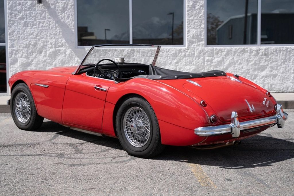 The rear 3/4 view of a red 1961 Austin-Healey 3000 Mk1