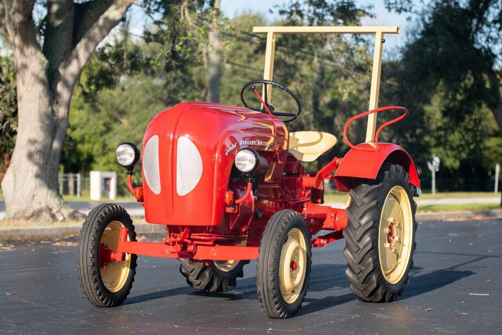 A red 1961 Porsche Junior 108 diesel tractor