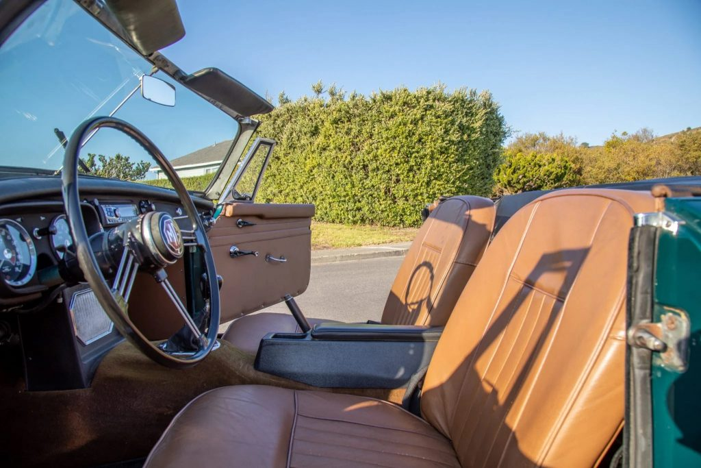 The tan leather interior of a 1965 MG MGB