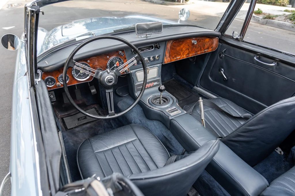 The blue-leather front seats and walnut dashboard of a 1967 Austin-Healey 3000 Mk3 BJ8