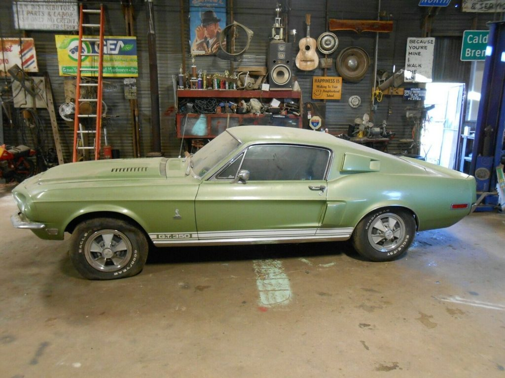 Driver's side profile view of a lime green 1968 Shelby GT350