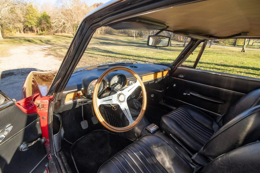 The 1971 Alfa Romeo GT 1300 Junior's black-leather front seats and wooden dashboard