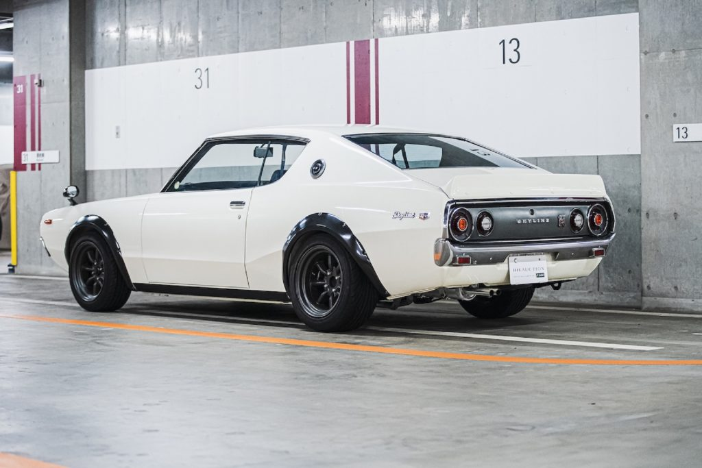 The rear 3/4 view of a white 1973 'Kenmeri' KPGC110 Nissan Skyline GT-R