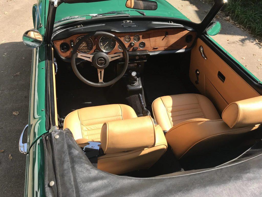 The tan-leather interior of a 1974 Triumph TR6