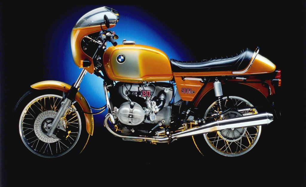 The side view of an orange-and-white 1975 BMW R90S