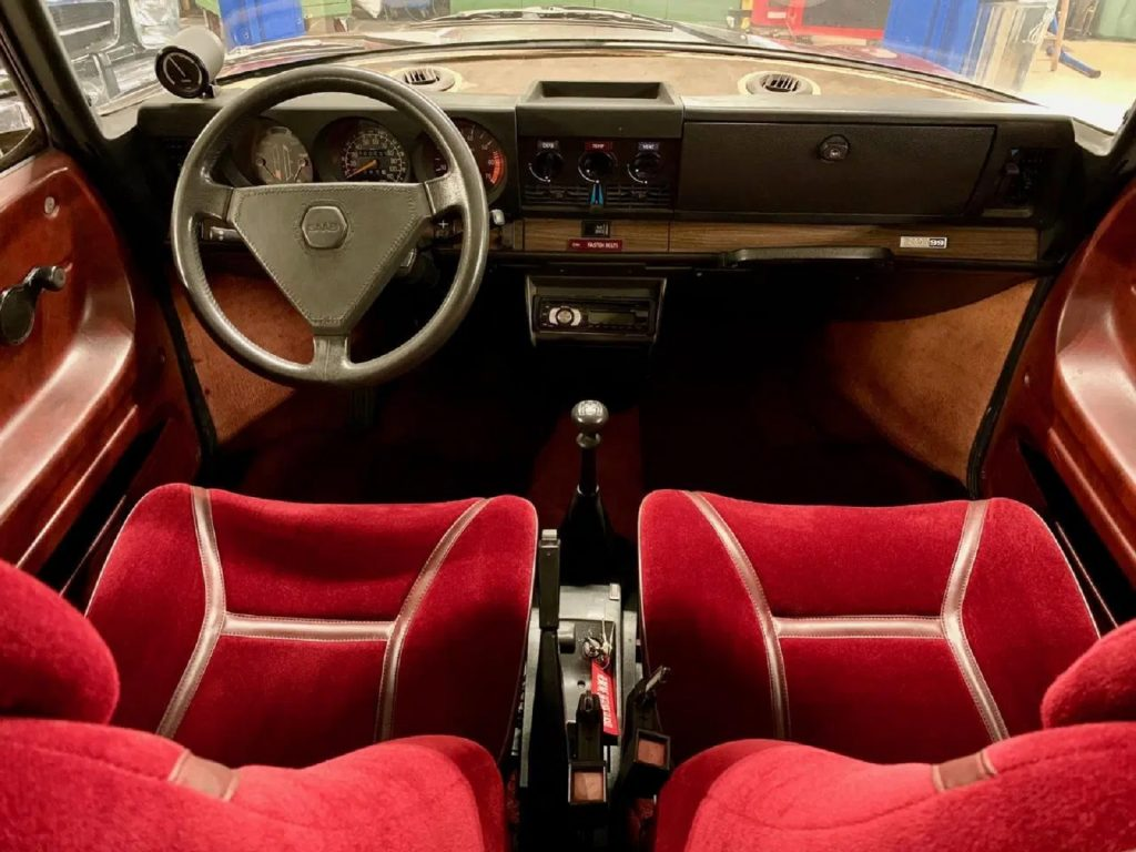 The 1978 Saab 99 Turbo's red velour front seats and wood dashboard