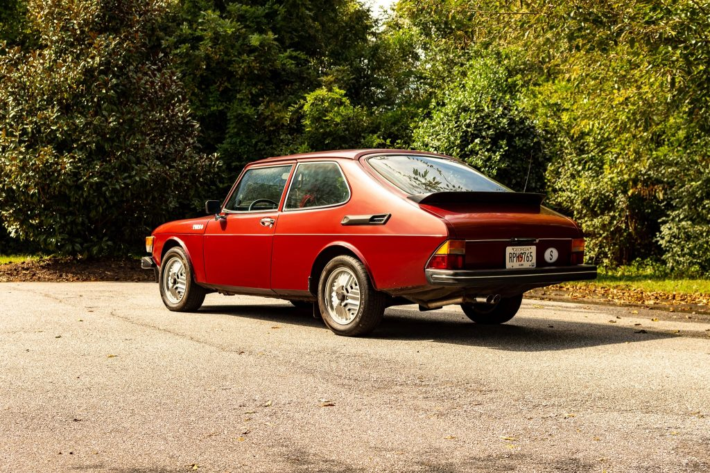 The rear 3/4 view of a red 1978 Saab 99 Turbo
