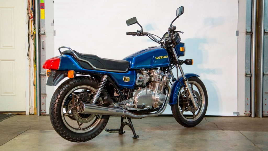 The rear 3/4 view of a blue 1980 Suzuki GS750 E