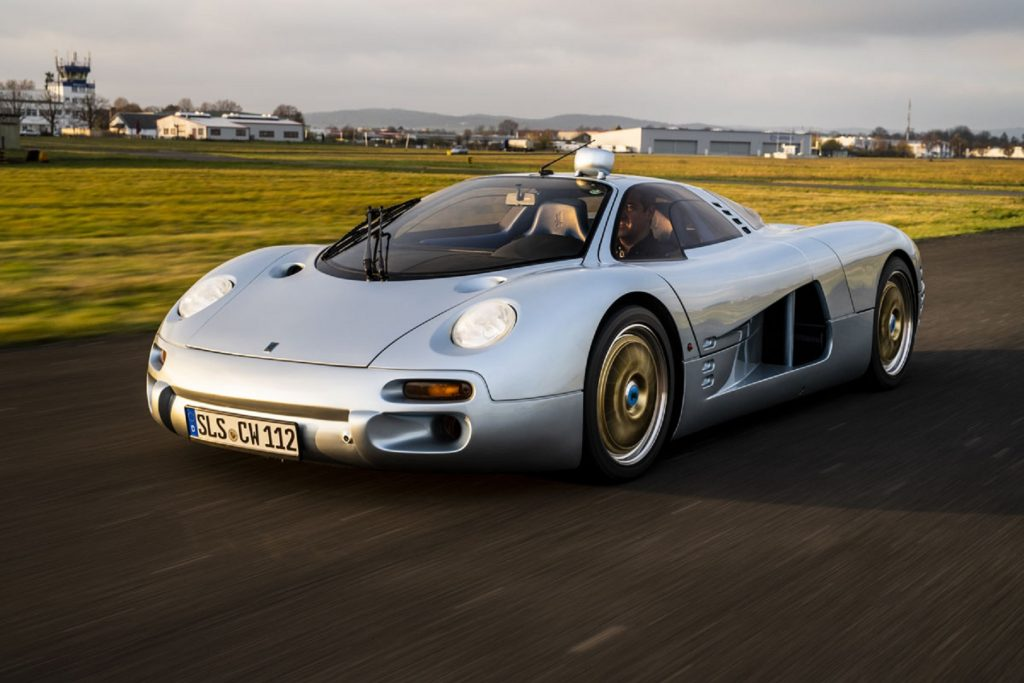 The silver 1993 Isdera Commendatore 112i on a track