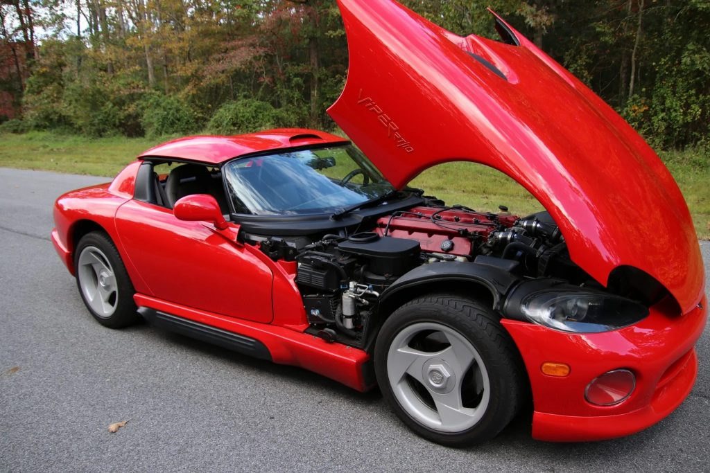 A red 1994 Dodge Viper RT/10 with its hood open