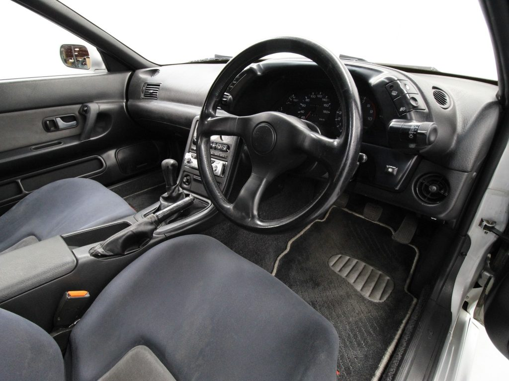 The 1994 Nissan R32 Skyline GT-R's front seats and black dashboard
