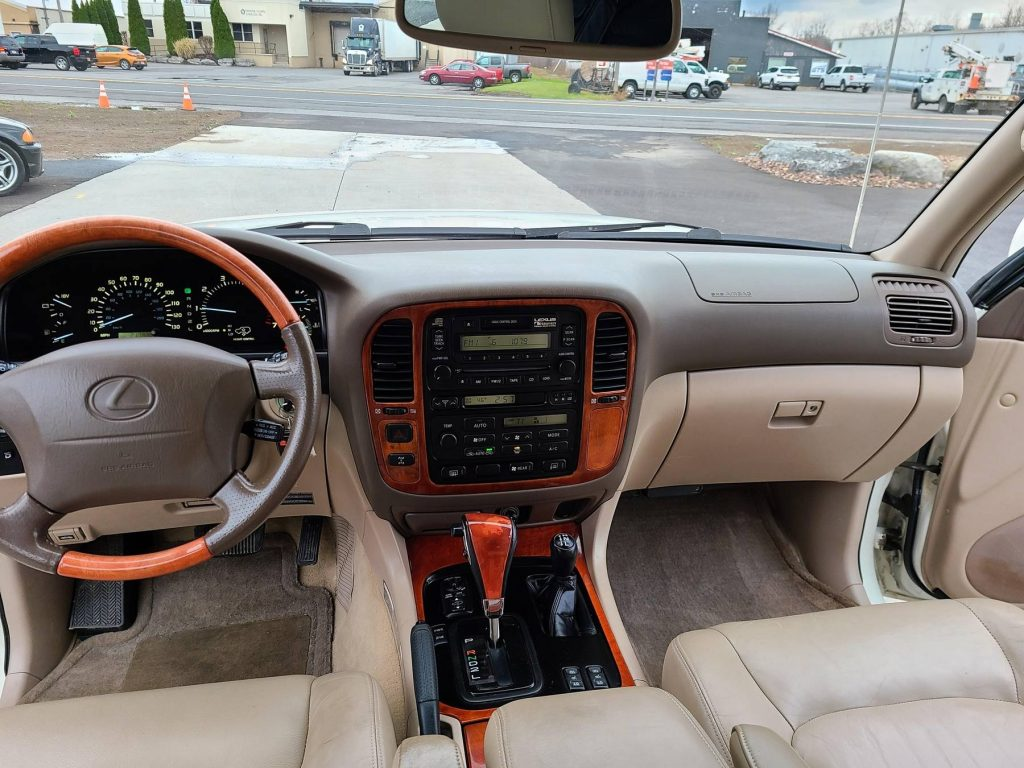 The 2000 Lexus LX 470's tan leather front seats and dashboard
