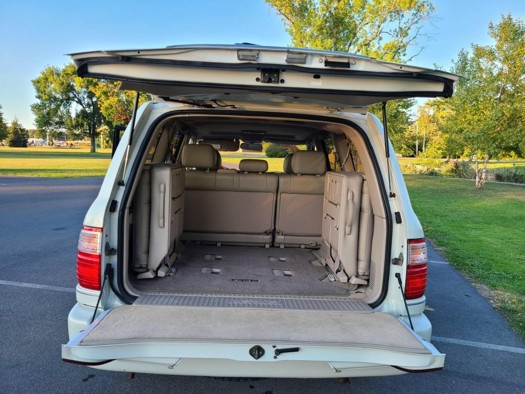 The 2000 Lexus LX 470's 3rd-row seats viewed from the open tailgates