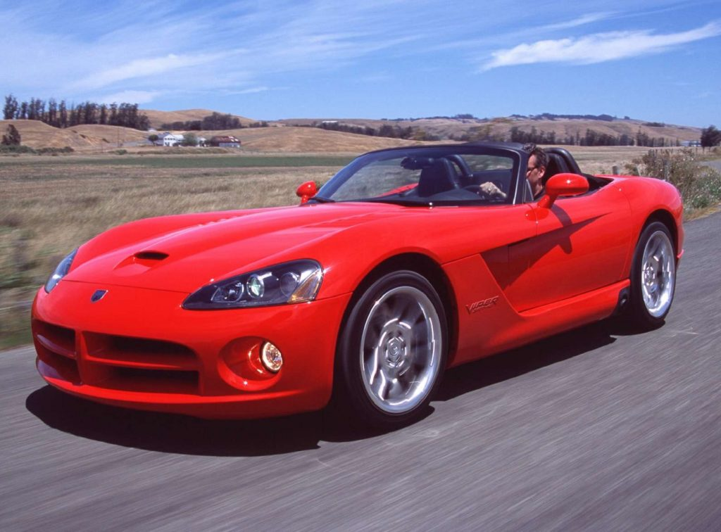 A red 2003 Dodge Viper SRT10 on the street