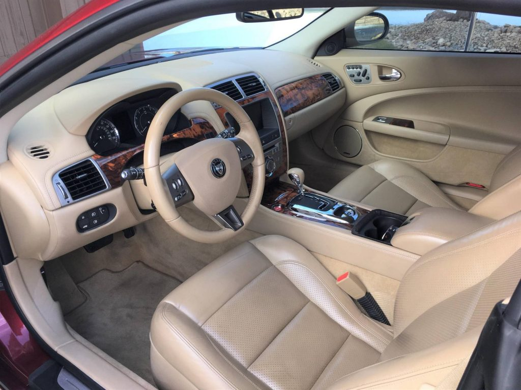 The tan-leather-upholstered 2008 Jaguar XK's interior