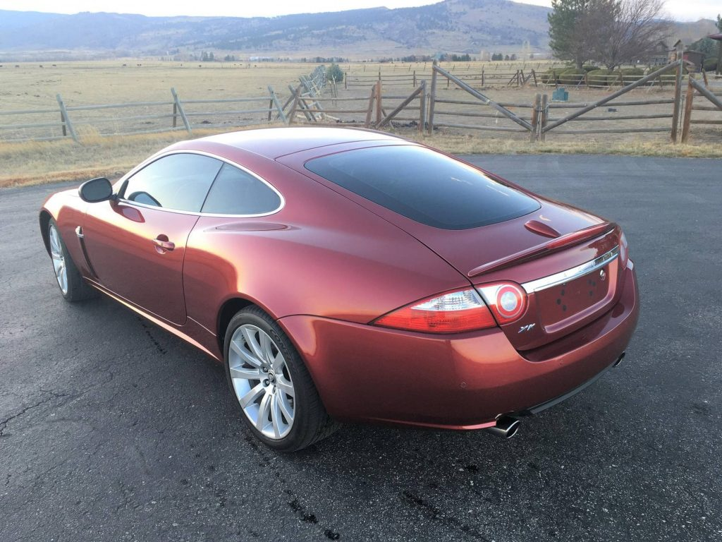 The rear 3/4 view of a red 2008 Jaguar XK coupe