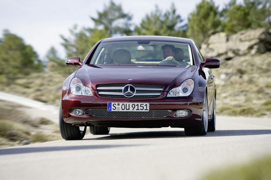 A burgundy 2008 Mercedes-Benz CLS-Class, CLS 280 navigates a mountainous road